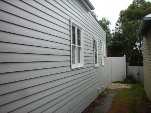 Replaced and painted weatherboards on Melbourne weatherboard house