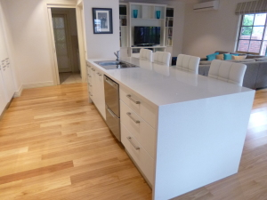 Caeser stone bench tops with vinyl wrap kitchen doors and draws and Black Butt timber flooring