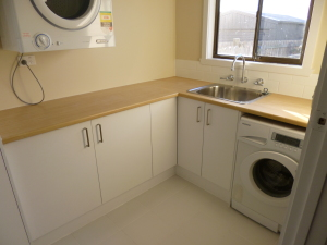 New laundry cabinets and benches