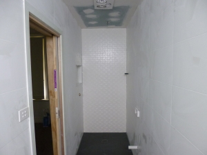 Tiled walls and floor in bathroom ensuite extension