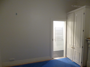 Painted bedroom wall and cavity sliding door